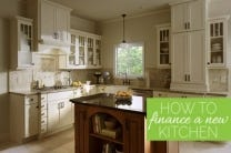text how to finance your new kitchen overlaid on image of kitchen with white shaker glass door cabinets and dark cherry center island