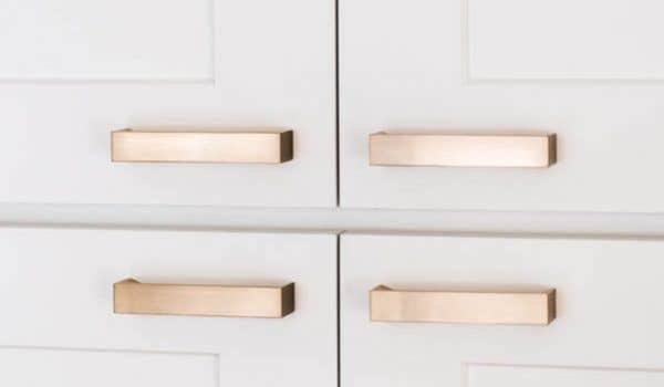 four gold cabinet hardware door pulls on cloud white cabinets