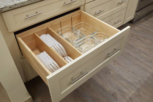 CliqStudios Dayton Cabinet in Painted Linen Multi-Storage Drawer cabinet organizing glass containers.