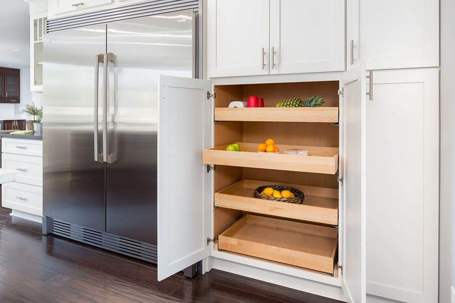 modern kitchen cabinets include pantry with roll-out shelves and custom built-in refrigerator surround.