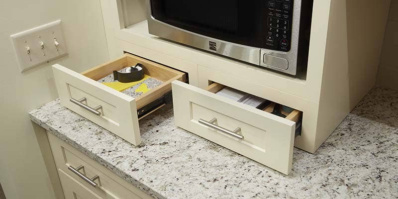 Wall furniture drawers underneath a microwave shelf, styled in Dayton, Painted Linen.