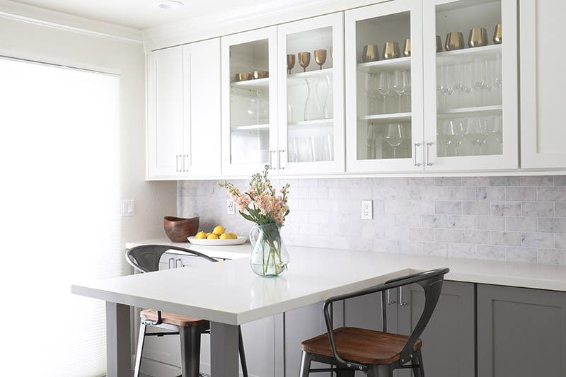A gray and white two-toned kitchen using CliqStudios Dayton cabinets in White and Studio Gray.