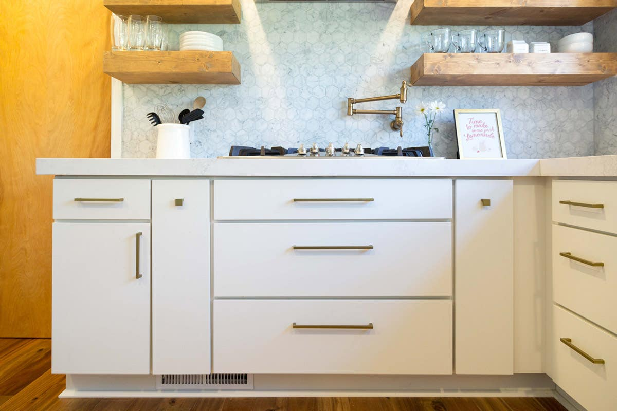 Here, the top drawer pulls are centered while the bottom pulls are raised. The distance from the drawer's top edge to the handlebar is equal for all drawers.