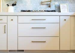Image of a kitchen using CliqStudios Style 31 cabinets painted white.