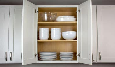 white cabinet with melamine finished interior and shelving