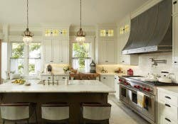 a traditional kitchne style white inset cabinetry kitchen island