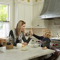 Mom and child in remodeled white kitchen in St Paul