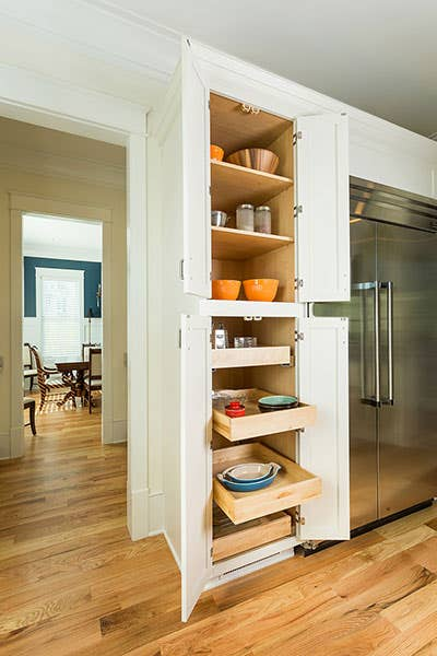 Tall pantry cabinet with upper shelves and bottom roll-out trays, shown in a Shaker style and White paint.