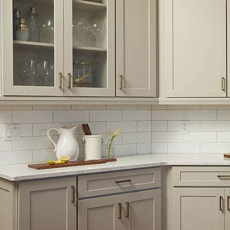 Kitchen with gray CliqStudios cabinets and white subway tile backsplash
