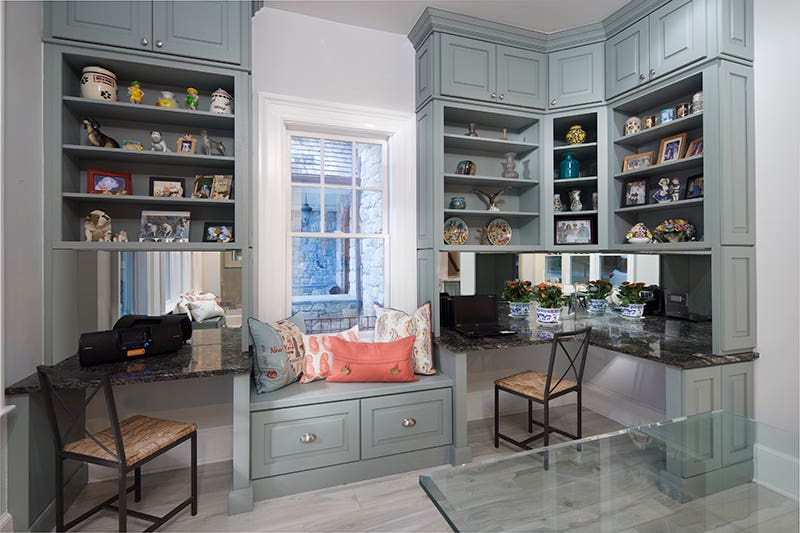A stunning display, this ground-to-ceiling cabinetry design uses lavish shelving to create a dazzling space.