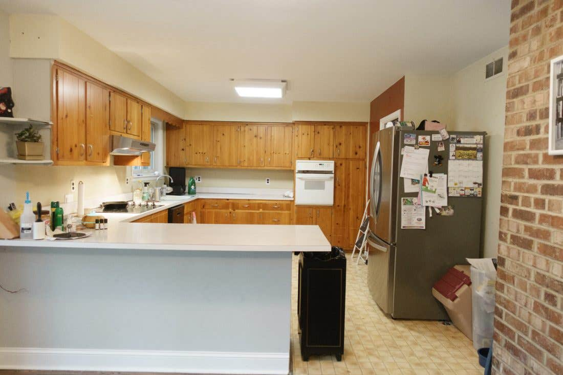 This kitchen was dated with old wood cabinets and a no designated space for the refrigerator