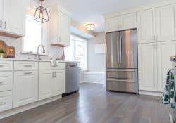 CliqStudios Cambridge kitchen in White showing the work triangle of the sink, refrigerator, and cooktop