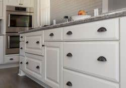 white base cabinet drawers with cup pulls