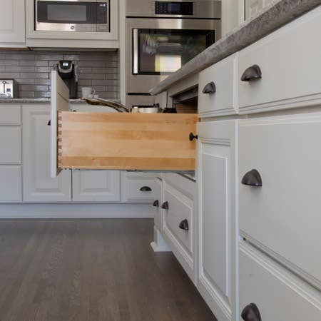 Open pot and pan drawer with hardwood sides and dovetail joints