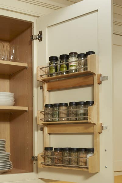 door mount spice rack placed on the inside of a Linen, Dayton Cabinet.