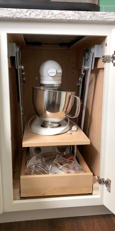 Base Cabinet for Stand Mixer storage, containing a standing mixer on the top shelf and mixing accessories on the bottom shelf.