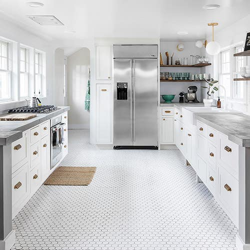 Black and white kitchen with shaker with large pantry wall