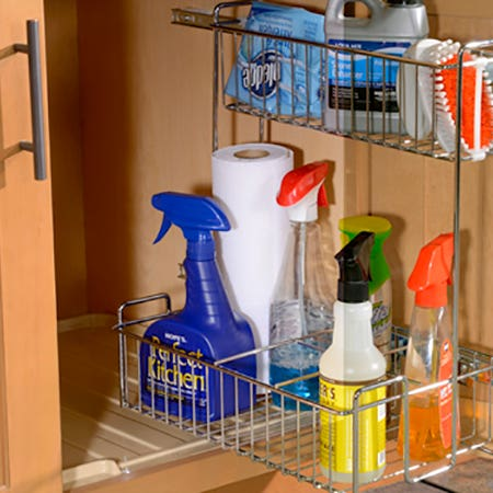 How do I clean and maintain my kitchen cabinets