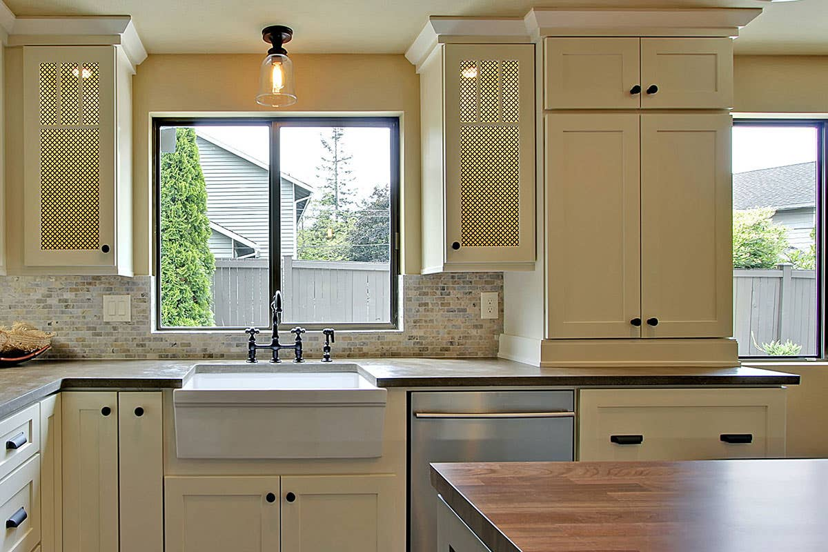 black knobs and cup pulls white shaker kitchen brick backsplash