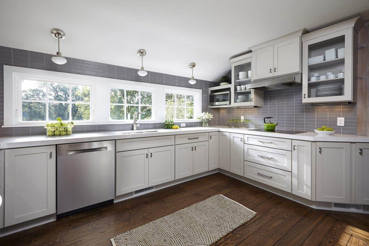 Modern gray kitchen featuring CliqStudios Dayton cabinet style in Painted Urban Stone gray.