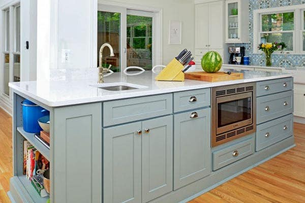 large kitchen island finished in Harbor with a white countertop