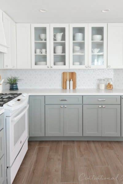CliqStudios cabinets in Dayton Painted White and Painted Harbor gray are the perfect timeless choice in a kitchen makeover by blogger Kate Riley of CentsationalGirl.com