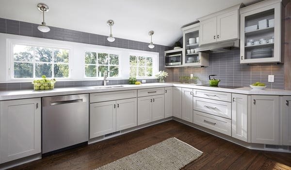 pale gray cabinets in kitchen in remodeled historic guest house