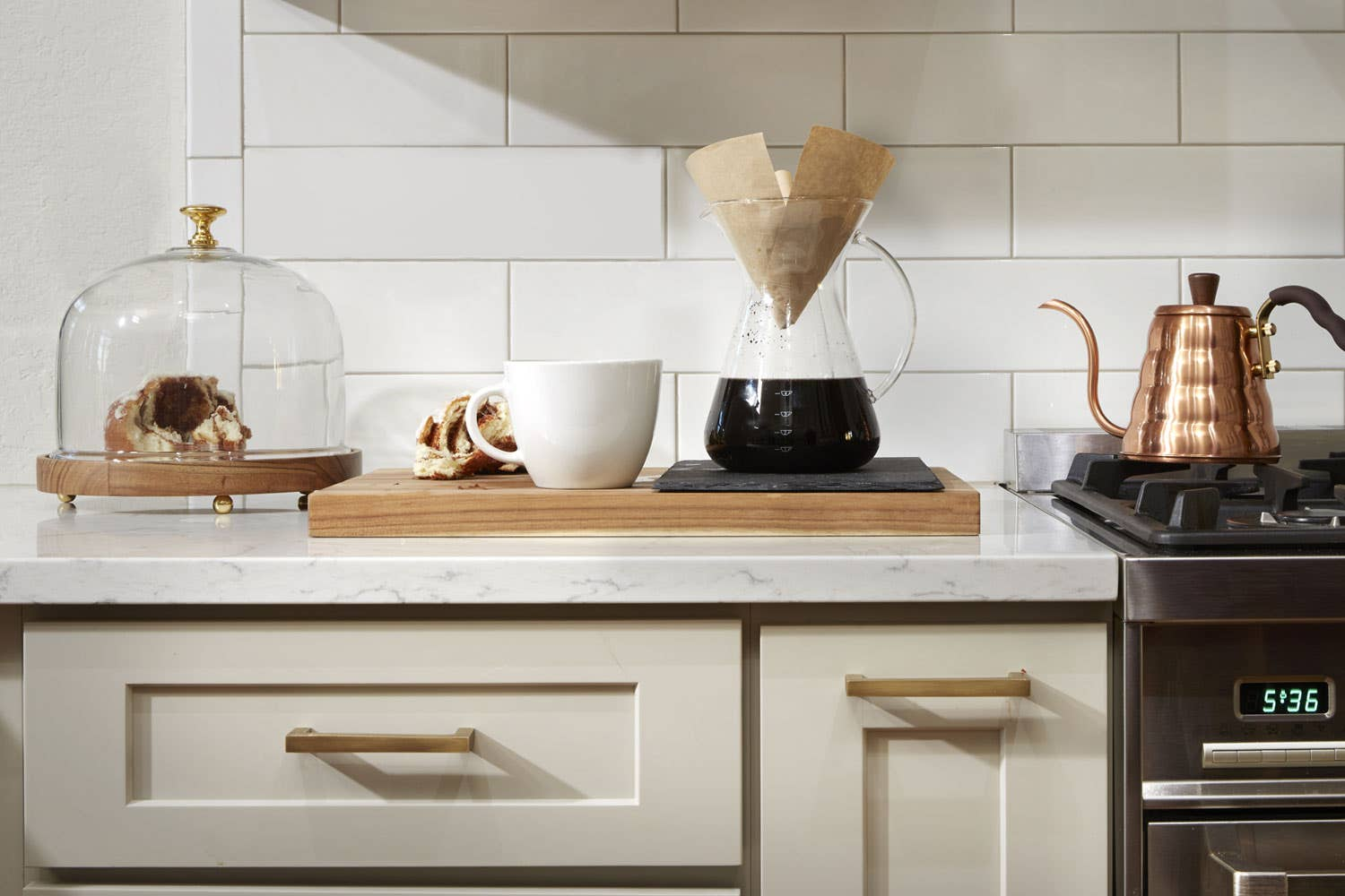 dayton white kitchen cabinets with pastries and pour over coffee brewing on countertop