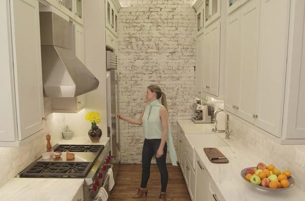 woman in nyc apartment with kitchens with tall cabinets