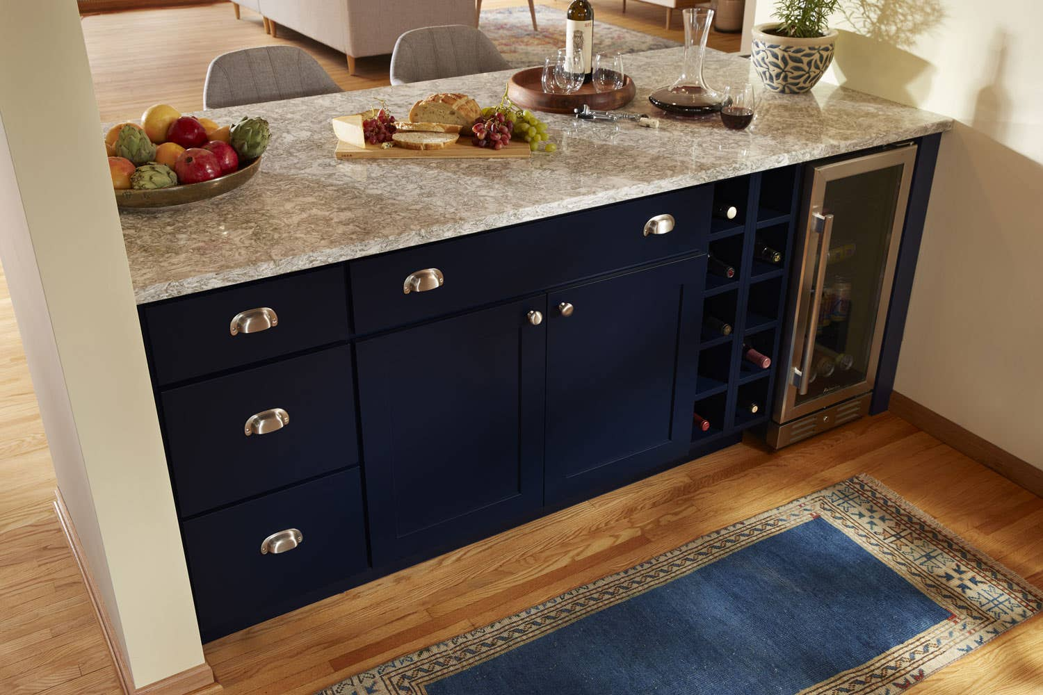 Matching cup pulls and knobs on navy cabinet.