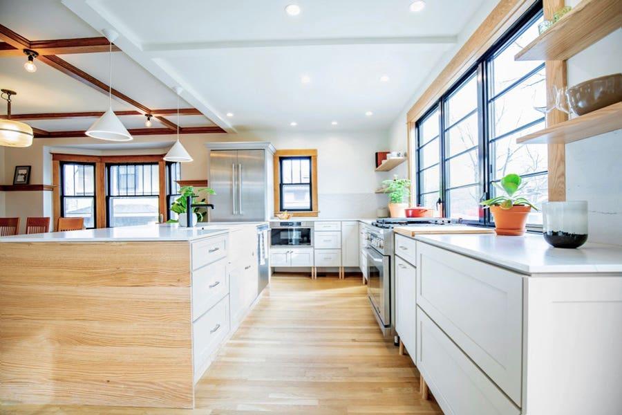 White Cabinets with Legs in a Modern Minimalist Kitchen