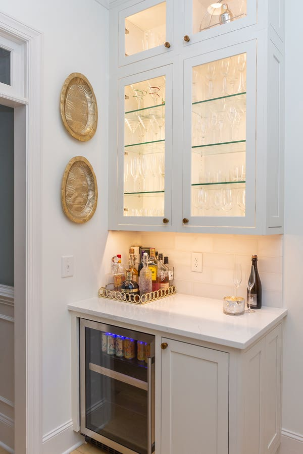 White cabinet Butler's pantry with wine refrigerator and glass door fronts