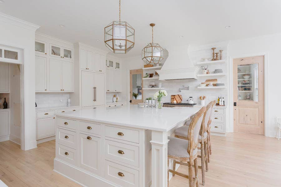 Massive custom built island with sink, microwave and specialty cabinet storage.