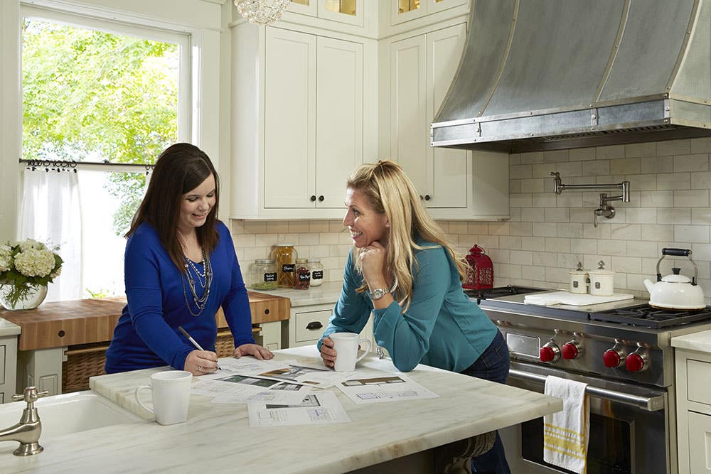 kitchen designer and homeowner discuss plans