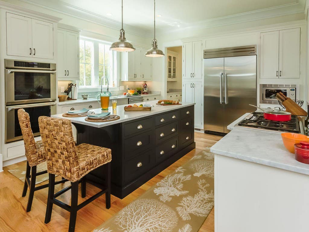 New home kitchen design features black inset cabinets in the center island, white shaker inset cabinets on the perimeter and a butlers pantry