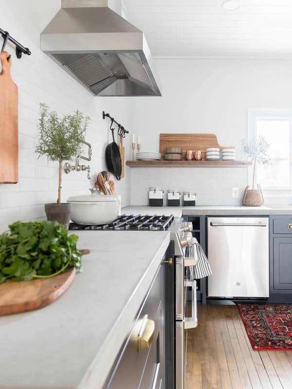 Blogger Ashley of Cherished Bliss creates a rustic modern kitchen using cement countertops, stainless steel appliances, and CliqStudios Austin inset cabinets in Carbon black paint.