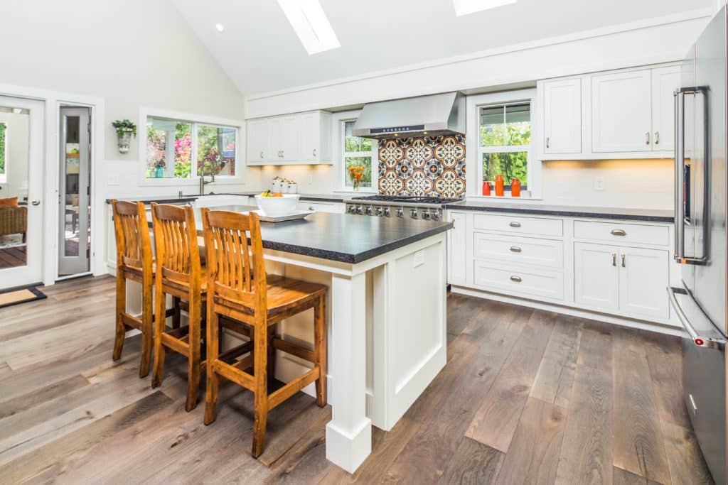 Large White Kitchen with Island and Tile Backsplash