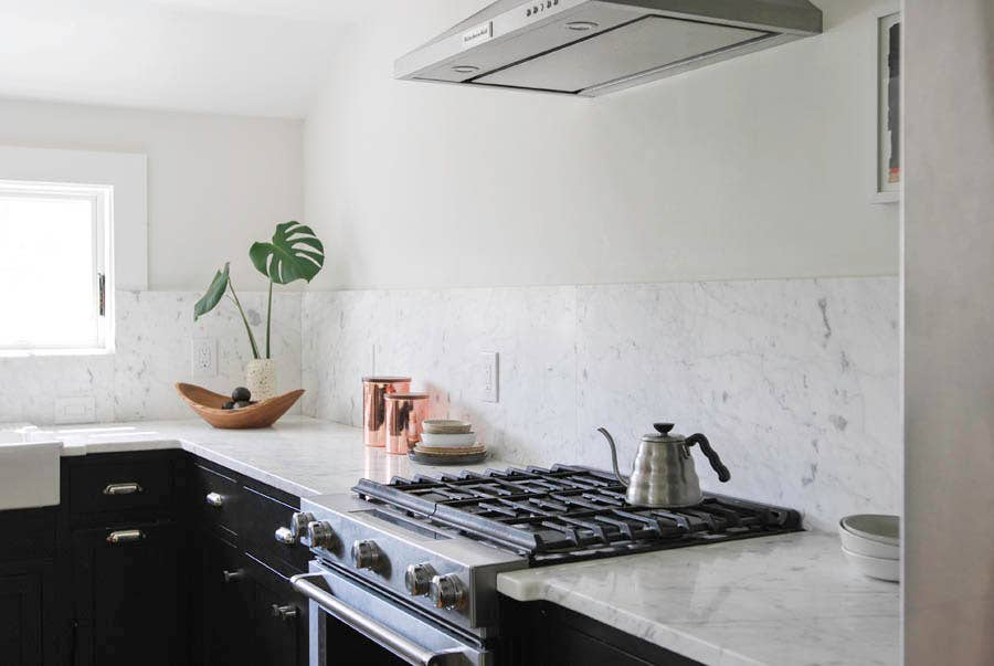Black Cabinets with White Countertops and Walls