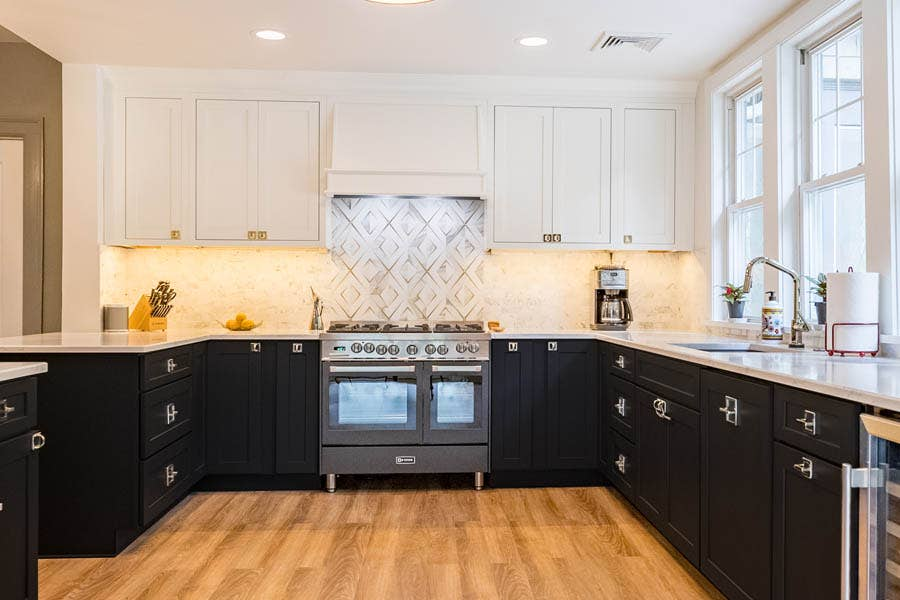 A black and white kitchen using CliqStudios Dayton cabinets, carbon on the base cabinets and white above.