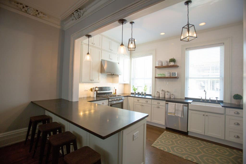 Photo gallery of remodeled kitchen features CliqStudios Dayton Painted White cabinets with nickel finish cup pulls