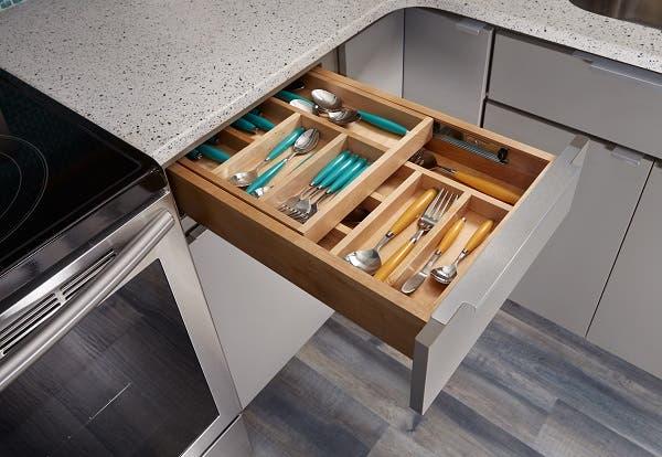 two-tier cutlery drawer open in gray slab door cabinets