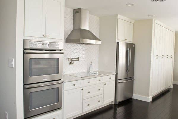 kitchen with wall of pantry cabinets