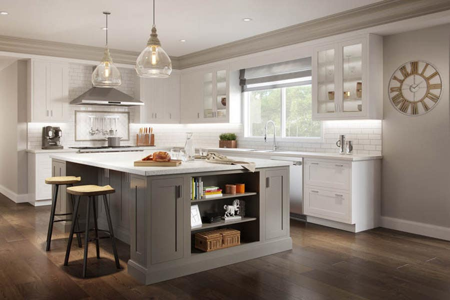 transitional style two-tone kitchen with inset Shaker cabinets, large gray island with open shelving, white perimeter cabinets with glass front cabinets surrounding the window and sink