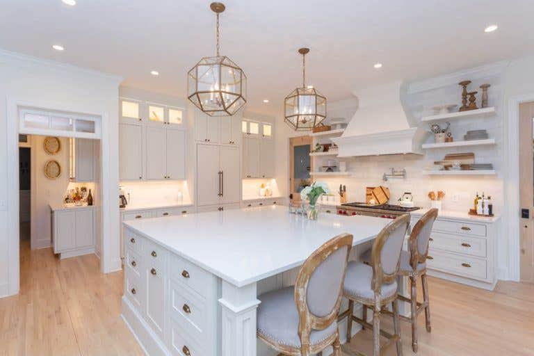 Kitchen with White Inset Door Shaker Cabinets, Large Island and Custom Build Range Hood