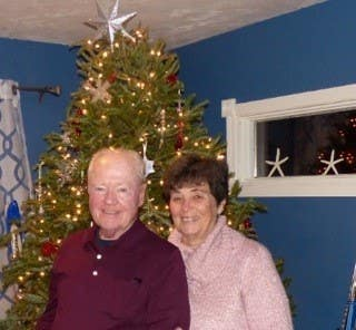 photo of CliqStudios customers Bob and RuthAnn Roth in front of a Christmas tree in their Cape Cod home