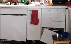 White MDF cabinets with broken drawer and hanging door