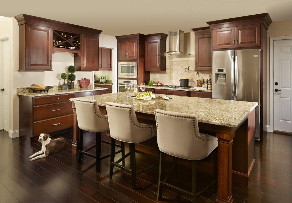 large kitchen with cherry cabinets and center island