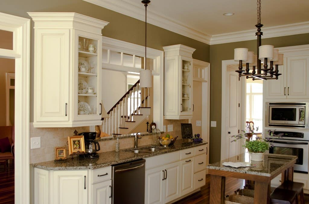 traditional kitchen with glazed linen raised panel door cabinets and oil brushed bronzed cabinet pulls and island pendant
