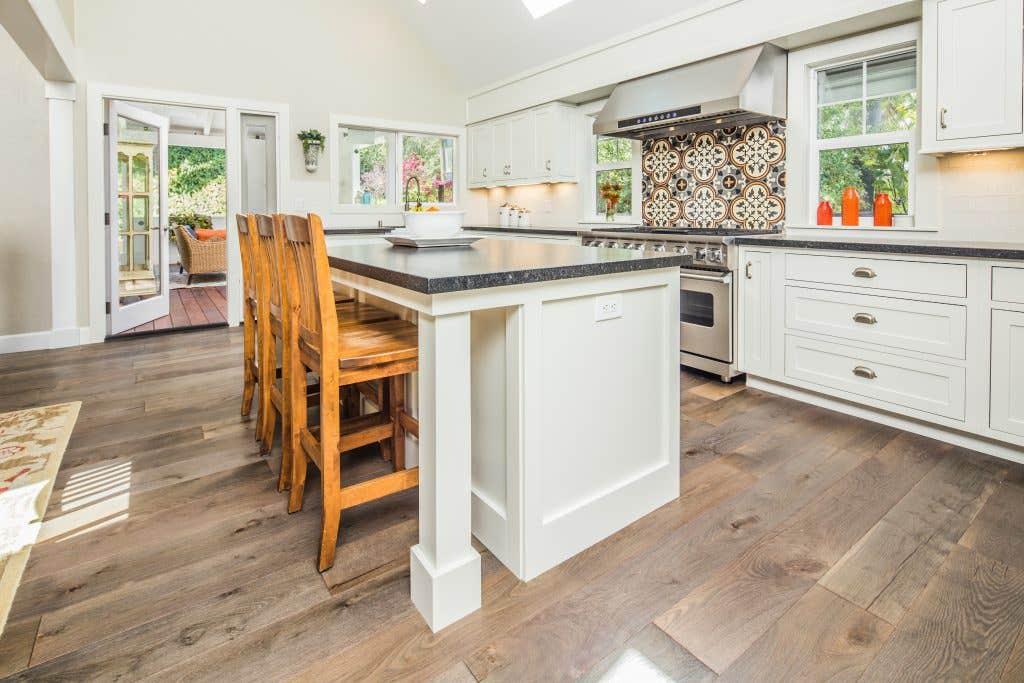 arge White Kitchen Island with Dark Countertop