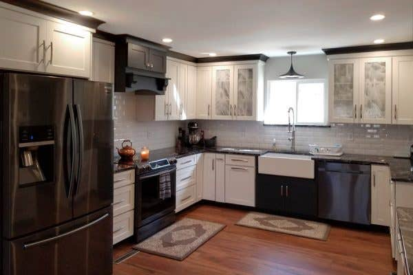 kitchen with white cabinets, and black accent cabinets and molding